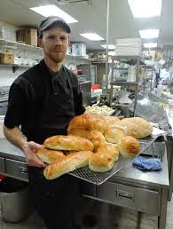 Matt Weafer, chef at Niko's baker, holds a tray of gourmet breads.